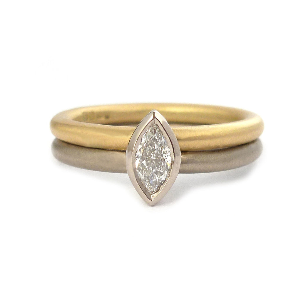 Contemporary, modern and bespoke 18k white and yellow gold with marquise diamond. Handmade stacking ring by Sue Lane Jewellery. A unique engagement ring.