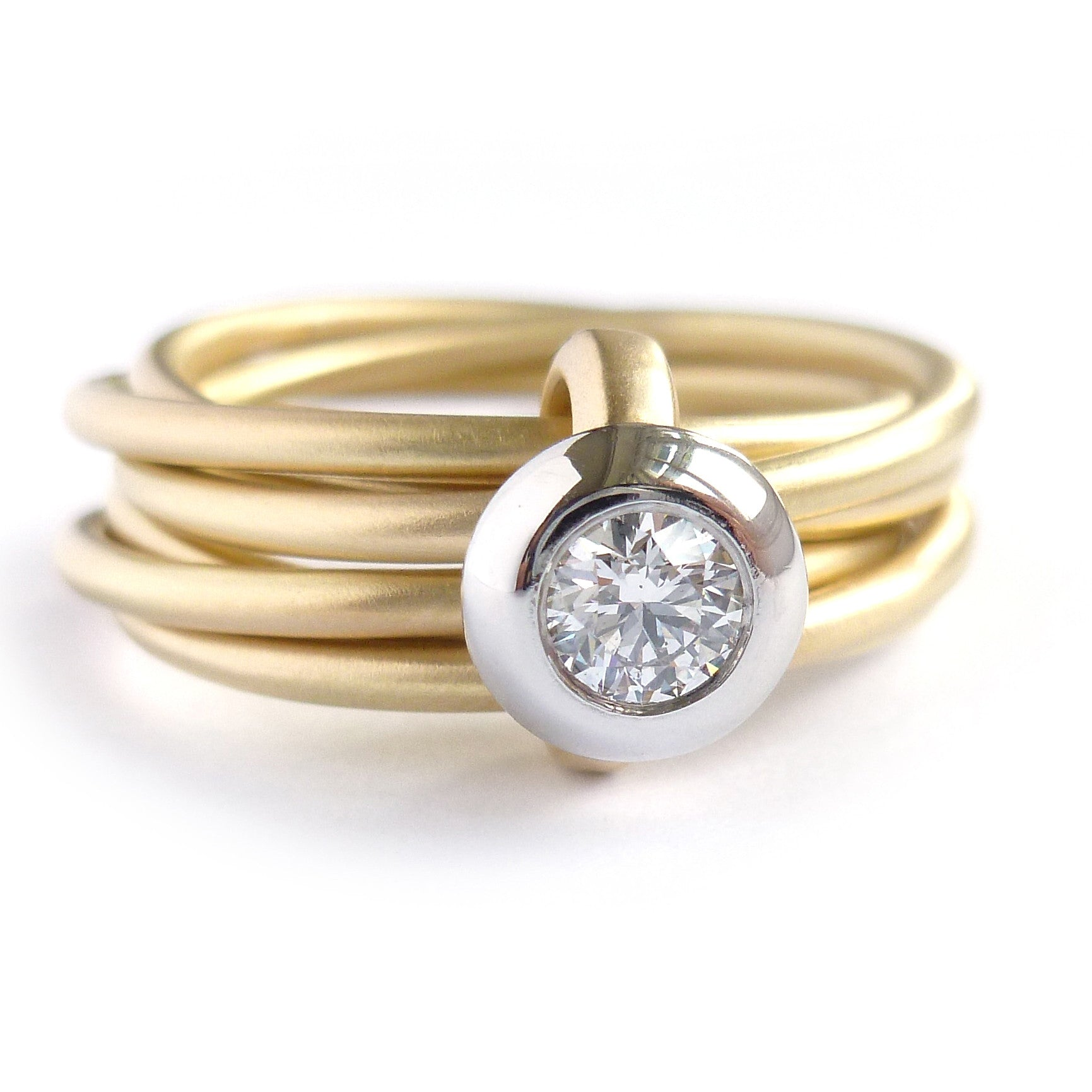 Contemporary, bespoke and modern yellow gold multi band engagement wedding ring, 0.25pt round white diamond, handmade by designer maker sue lane jewellery. Multi band ring or interlocking ring.
