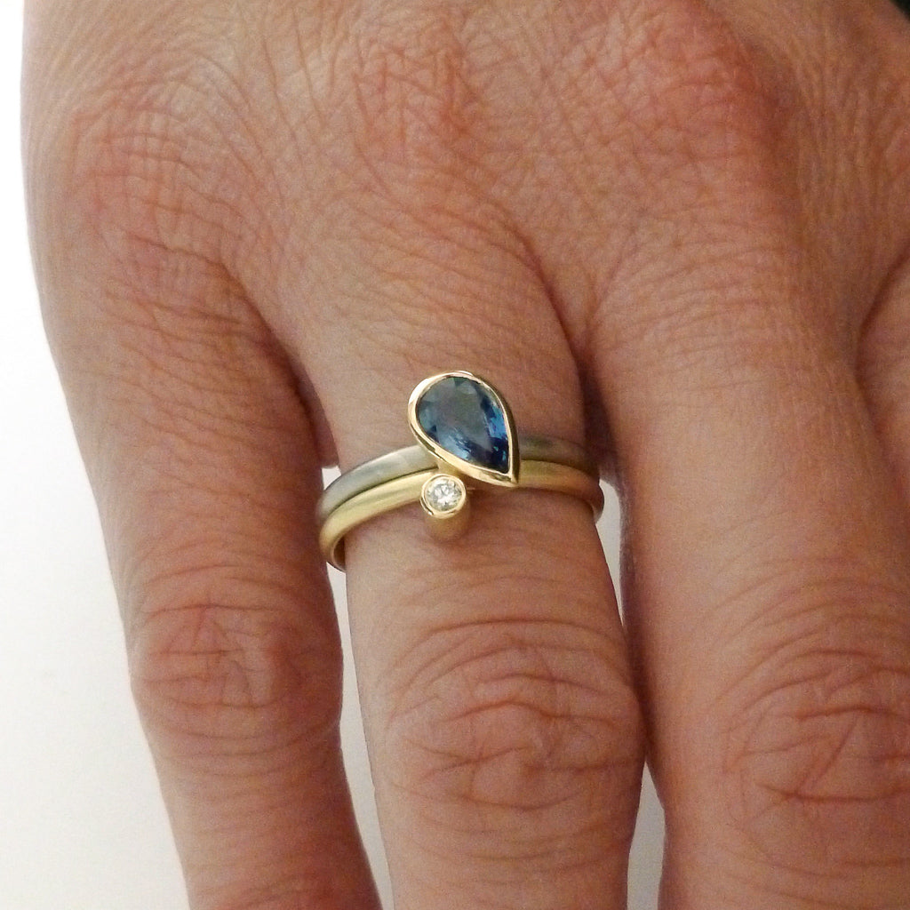 Modern cornflower blue ethically sourced sapphire and diamond stacking ring set by Sue Lane. Multi band ring or interlocking ring, sometimes called double band ring too.