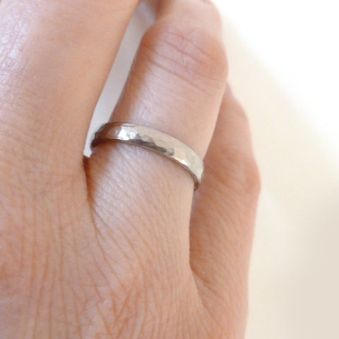 Contemporary, modern and bespoke hammered white gold wedding ring by designer maker Sue Lane Jewellery. Perfect wedding ring for men or wemon.