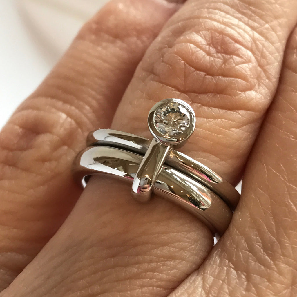modern contemporar platinum two band stacking ring wih round white diamond. A unique one of a kind design by Sue Lane