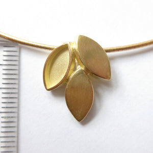 modern and simple yellow gold leaf inspired necklace handmade by Sue Lane UK