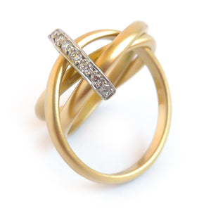 A unique contemporary unique two tone gold and diamond Russian style linked ring
