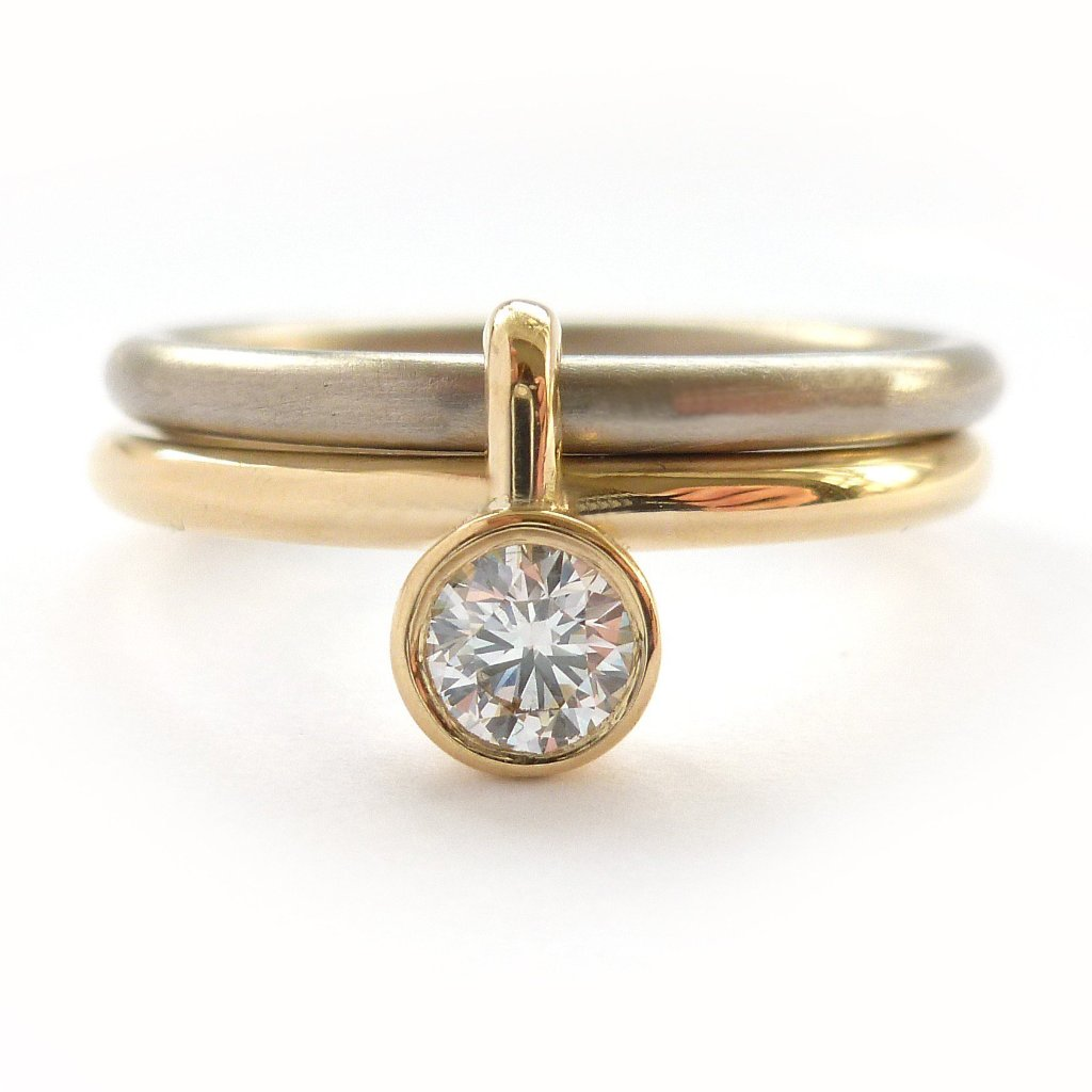 A unique modern contemporary 18ct gold two tone stacking engagement ring with white diamond. Multi band ring or interlocking ring, sometimes called double band ring too.