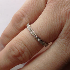 Beautiful contemporary platinum and diamond wedding or eternity ring