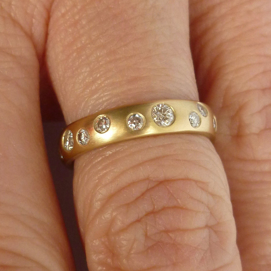 A modern unique eternity ring with 20 diamonds. Beautiful contemporary wedding, eternity or engagement ring.