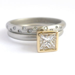 A beautiful, contemporary platinum and 18ct yellow engagement ring.