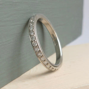 Classic platinum and diamond wedding or eternity ring