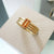 Contemporary 18ct gold ring with orange sapphire - handmade, designer, bespoke, custom Sue Lane.