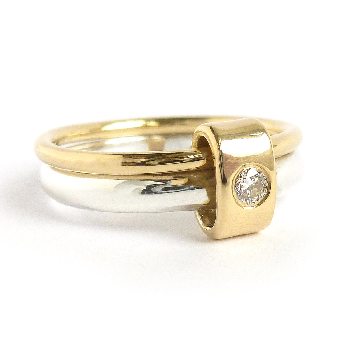 Contemporary jewellery engagement ring. Remodelling commissioning.