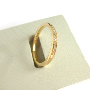 Contemporary jewellery eternity ring with diamonds. Remodelling commissioning.