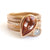 Contemporary rose gold and pear shaped imperial topaz stacking interlocking ring set.