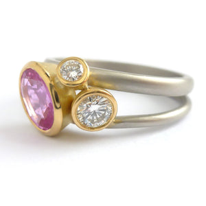 Platinum, 18ct gold, pink sapphire and two white diamonds ring. Contemporary, modern and unique.