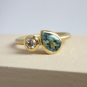 Contemporary, unique and modern aquamarine and diamond 18ct gold ring