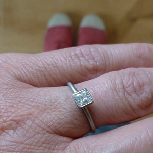 Platinum and square diamond engagement ring