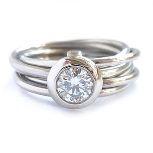 Contemporary bespoke Russian style Platinum diamond ring Sue Lane. Multi band ring or interlocking ring.