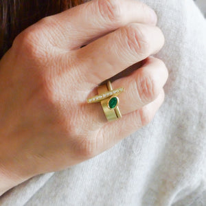 One off contemporary ring with lovely emerald and pave set diamonds. Totally bespoke and unique.