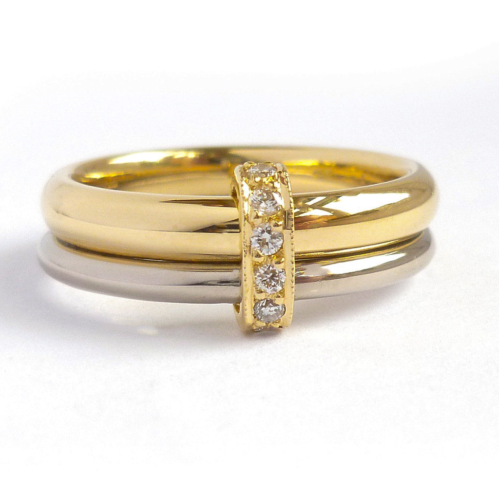 Two band 18ct yellow and white gold ring with diamonds. Contemporary, modern. Multi band ring or interlocking ring, sometimes called double band ring too.