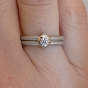 Contemporary platinum two band engagement ring with diamond. Bespoke. Multi band ring or interlocking ring, sometimes called double band ring too.