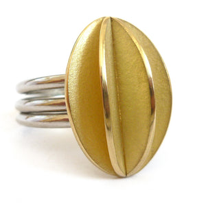 A totally unique and contemporary three platinum band ring with an 18ct gold leaf design. Completely original. Sue Lane.