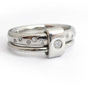 Platinum and diamond two band ring - modern, unique, contemporaryMulti band ring or interlocking ring, sometimes called double band ring too.
