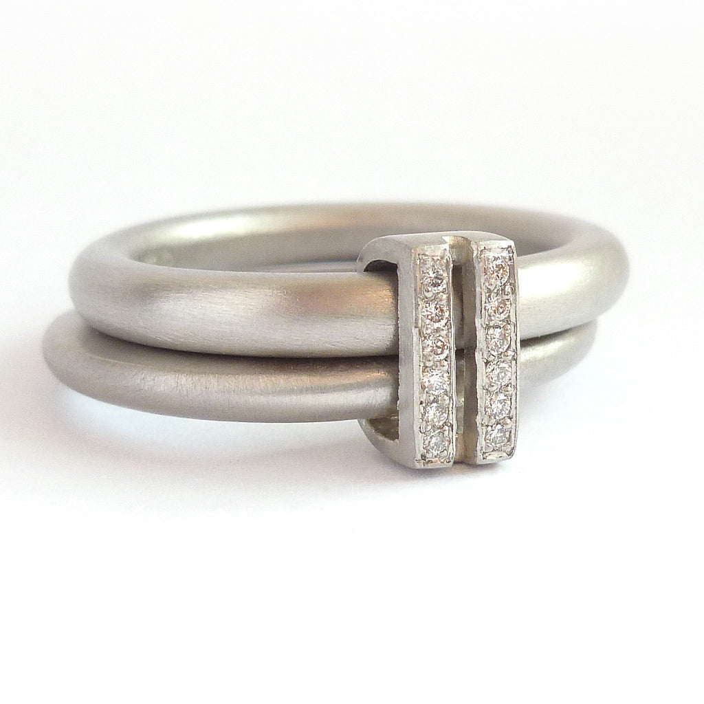 f41242535 Platinum two band ring with pave set diamonds. Contemporary. By Sue Lane.