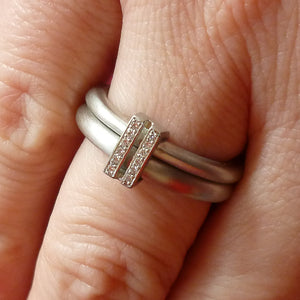 Platinum two band ring with pave set diamonds. Contemporary. By Sue Lane.