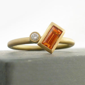A bespoke orange sapphire and diamond 18ct gold ring. Contemporary and unique.