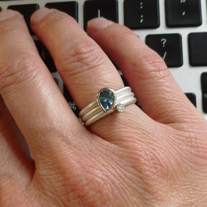 Contemporary, unique, bespoke, handmade and modern aquamarine and diamond engagement ring