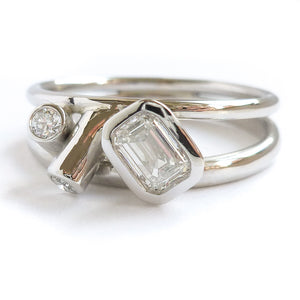 Modern two band platinum ring which can symbolise linking together in relationship