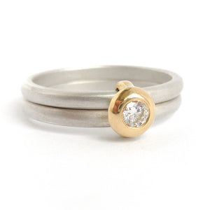 Contemporary modern yellow gold, silver diamond engagement ring, dress ring, eternity ring. Multi band ring or interlocking ring, sometimes called double band ring too.