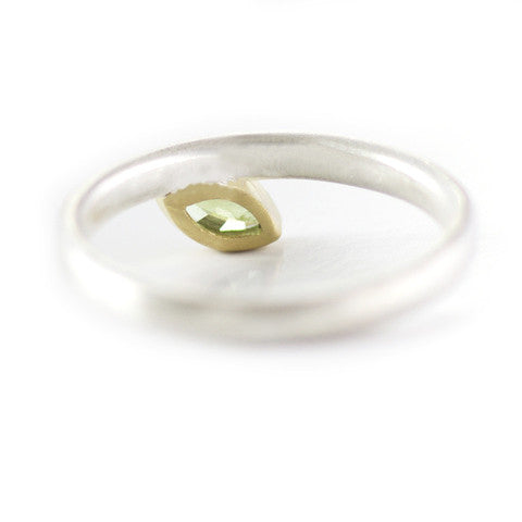Unusual, unique, bespoke and modern stacking ring in silver and yellow gold with green marquise peridot Handmade by Sue Lane Contemporary Jewellery UK