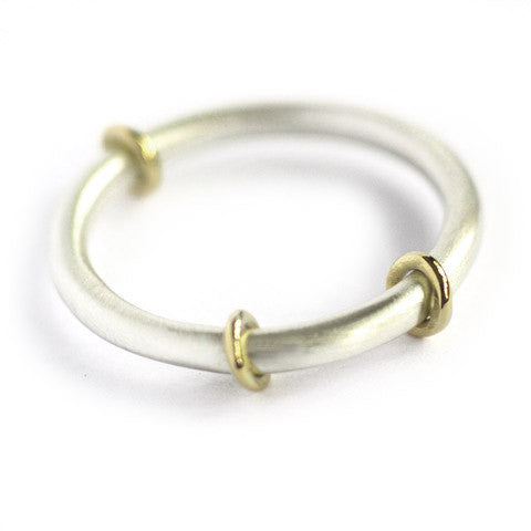 Contemporary, modern and bespoke silver and 18k gold ring, moving rings, handmade by Sue Lane Contemporary Jewellery. Perfect 21st birthday present!
