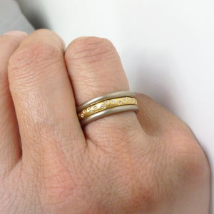A modern, contemporary gold eternity ring, wedding ring, or engagement ring