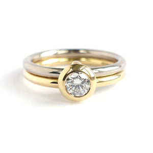 18ct white and yellow gold two band contemporary ring with certified diamond.