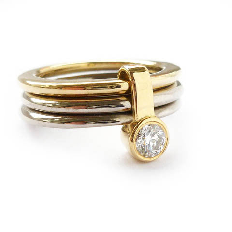 modern and unique chunky gold and diamond stacking ring set. Unique modern eternity ring or engagement ring. Multi band ring or interlocking ring, sometimes called triple band rings too.