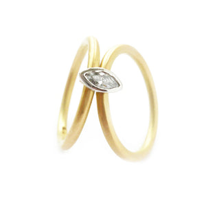 Contemporary, modern and bespoke 18k yellow gold and platinum marquise diamond ring. Handmade stacking ring by Sue Lane Jewellery. A unique engagement ring.