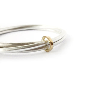 Unusual, unique, bespoke and modern silver and gold Russian style bangle with brushed finish. Handmade by Sue Lane Jewellery in Herefordshire, UK
