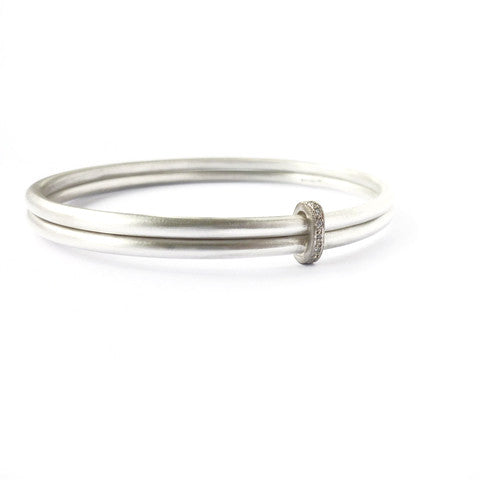 Unusual, unique, bespoke and modern two band silver, gold and pave diamond bangle with a brushed finish. Handmade by Sue Lane Contemporary Jewellery in Herefordshire, UK