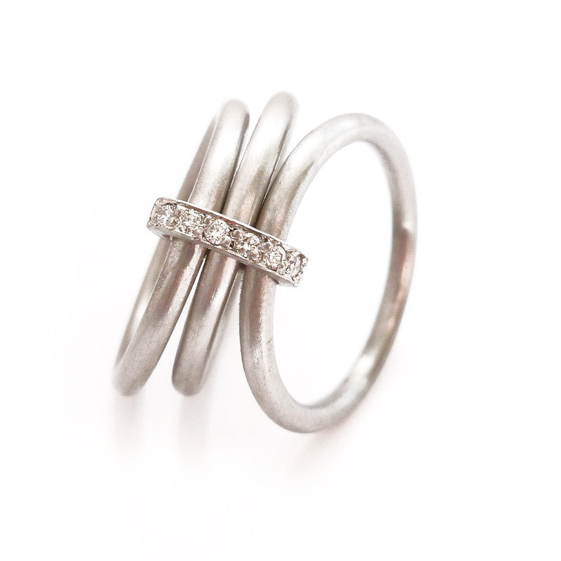 Unusual, unique, bespoke and modern Platinum and diamond wedding ring, contemporary eternity ring, engagement ring, Handmade by Sue Lane in Herefordshire, UK. Multi band ring or interlocking ring, sometimes called triple band rings too.