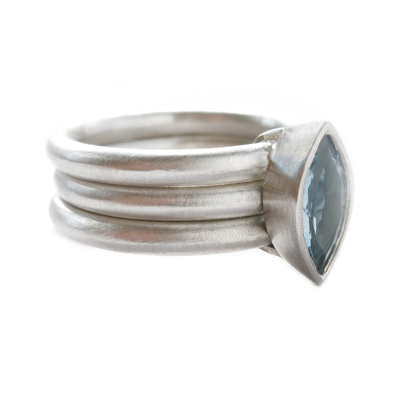 Unusual, unique, bespoke and modern three band stacking ring in silver and gold with dark blue aquamarine. Handmade by Sue Lane Jewellery in Herefordshire, UK