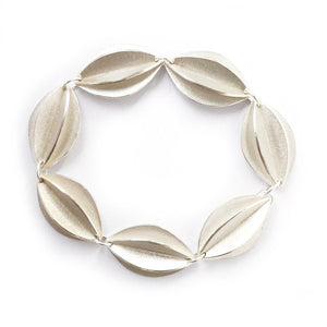 Contemporary sterling silver bracelet, leaf shape, handmade and bespoke by Sue Lane Jewellery. Perfect for Silver wedding anniversary, 21st birthday present.