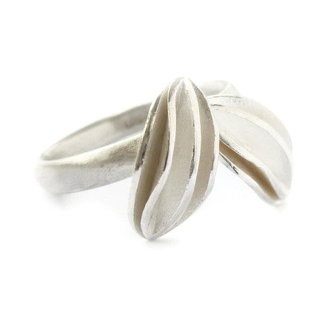 Unusual, unique, bespoke and modern sterling silver ring with two leaf shapes and brushed finish. Handmade by Sue Lane Contemporary Jewellery in Herefordshire.