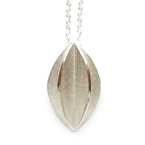 Unusual, unique, bespoke and modern silver leaf pendant necklace with brushed finish. Handmade by Sue Lane Contemporary Jewellery in Herefordshire, UK.