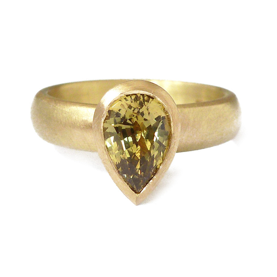 Unusual, bespoke and modern gold and pear shape green/yellow sapphire dress or engagement ring handmade by designer maker Sue Lane contemporary Jewellery, UK