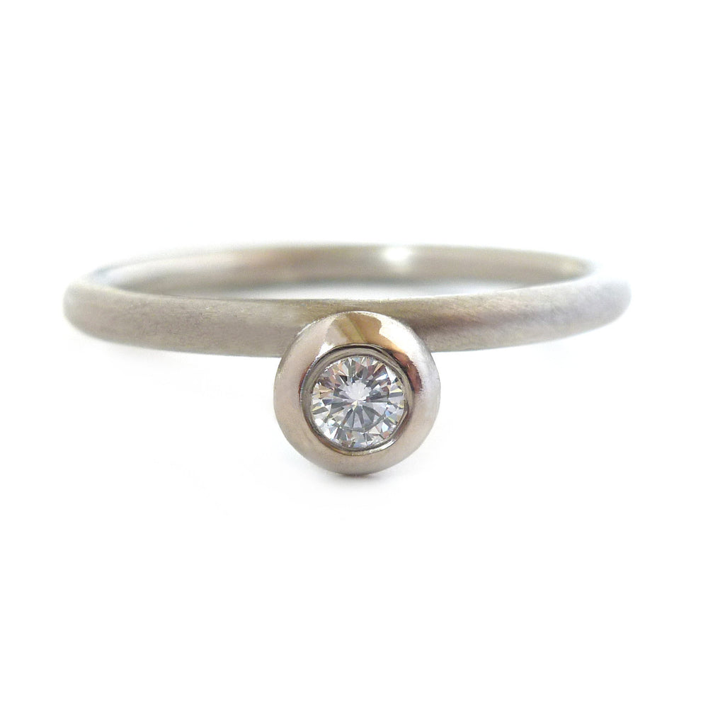 Contemporary, modern and bespoke Silver, 18k white gold and round white diamond handmade stacking ring by Sue Lane Jewellery. Unique, alternative engagement ring