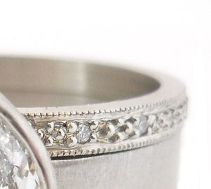 Contemporary, unique, bespoke and modern platinum marquise diamond engagement / wedding ring, eternity ring, matt brushed finish. Handmade by Sue Lane in Herefordshire, UK