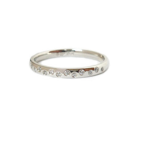 Contemporary, unique, bespoke and modern platinum diamond wedding ring, engagement ring, eternity ring, matt brushed finish. Handmade by designer maker Sue Lane