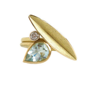 Unique, modern and contemporary two band ring, set with a pear shape aquamarine. Dress ring or alternative engagement ring. Handmade designer Sue Lane Jewellery