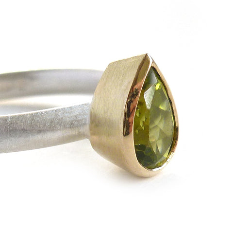 Contemporary, modern and bespoke silver and 18k gold green pear shape peridot stacking ring, handmade and commission Sue Lane Jewellery/ Alternative engagement